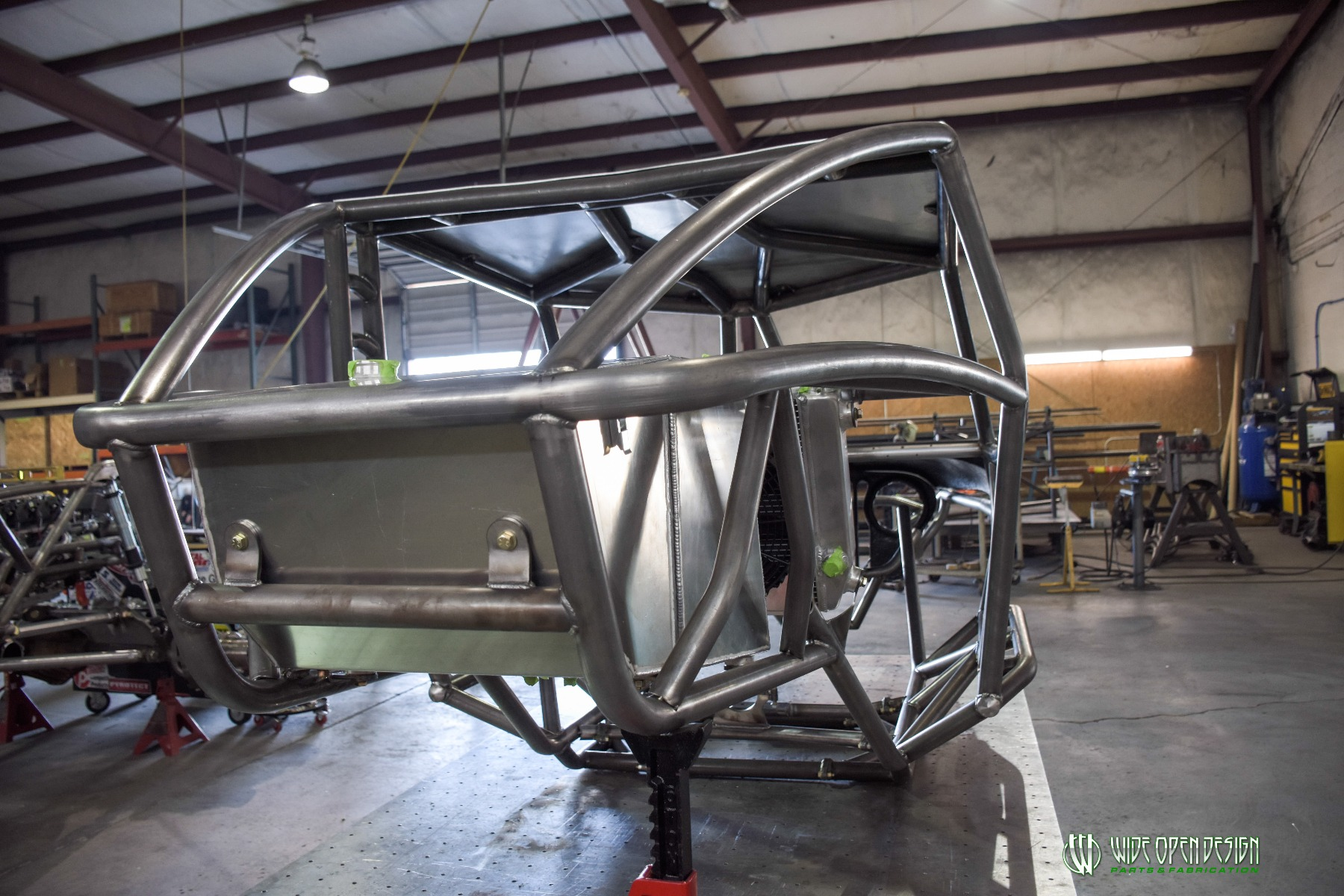 Wide Open Design Evolution Rock Crawler chassis with jeep hood and grill rear 9