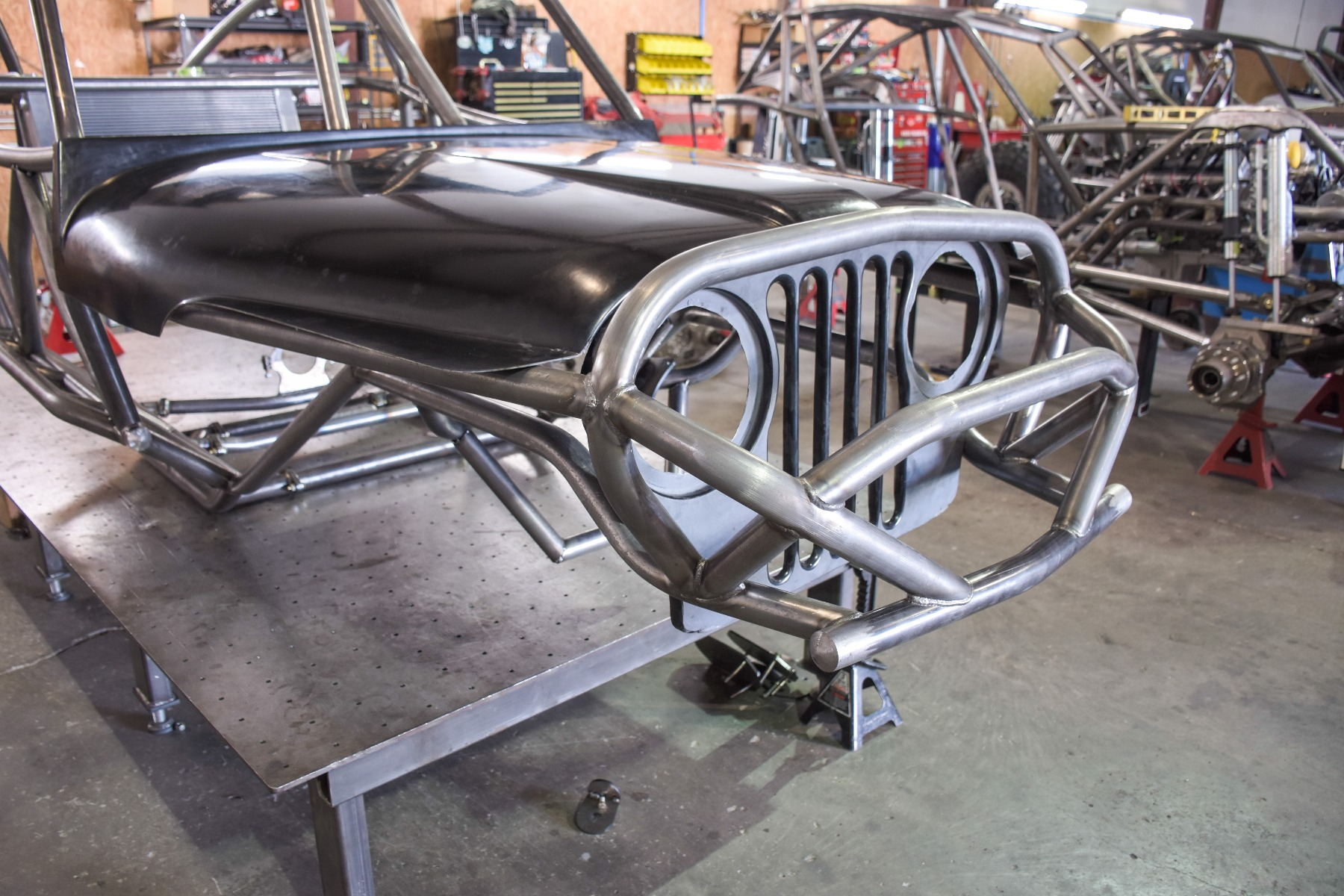 Wide Open Design Evolution Rock Crawler chassis with jeep hood and grill front detail 15