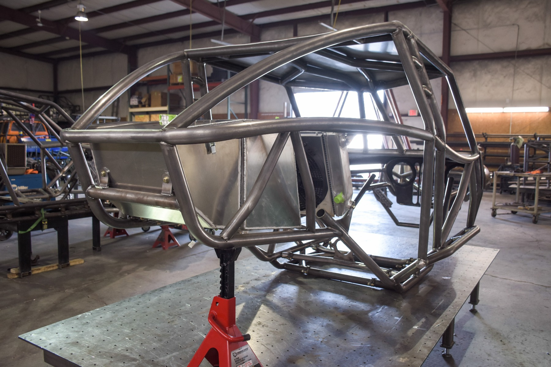 Wide Open Design Evolution Rock Crawler chassis with jeep hood and grill fuel cell rear 17