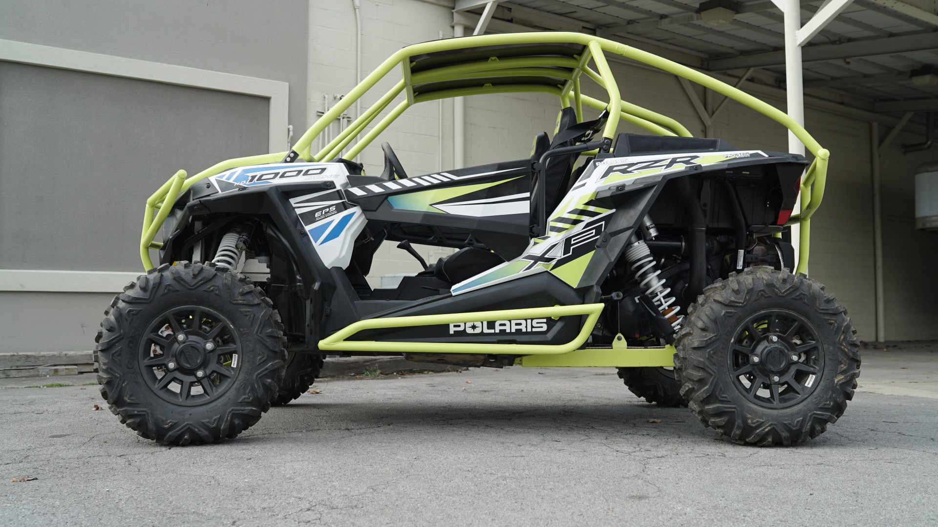 Polaris RZR 1000 with Yellow Roll Cage Image 3