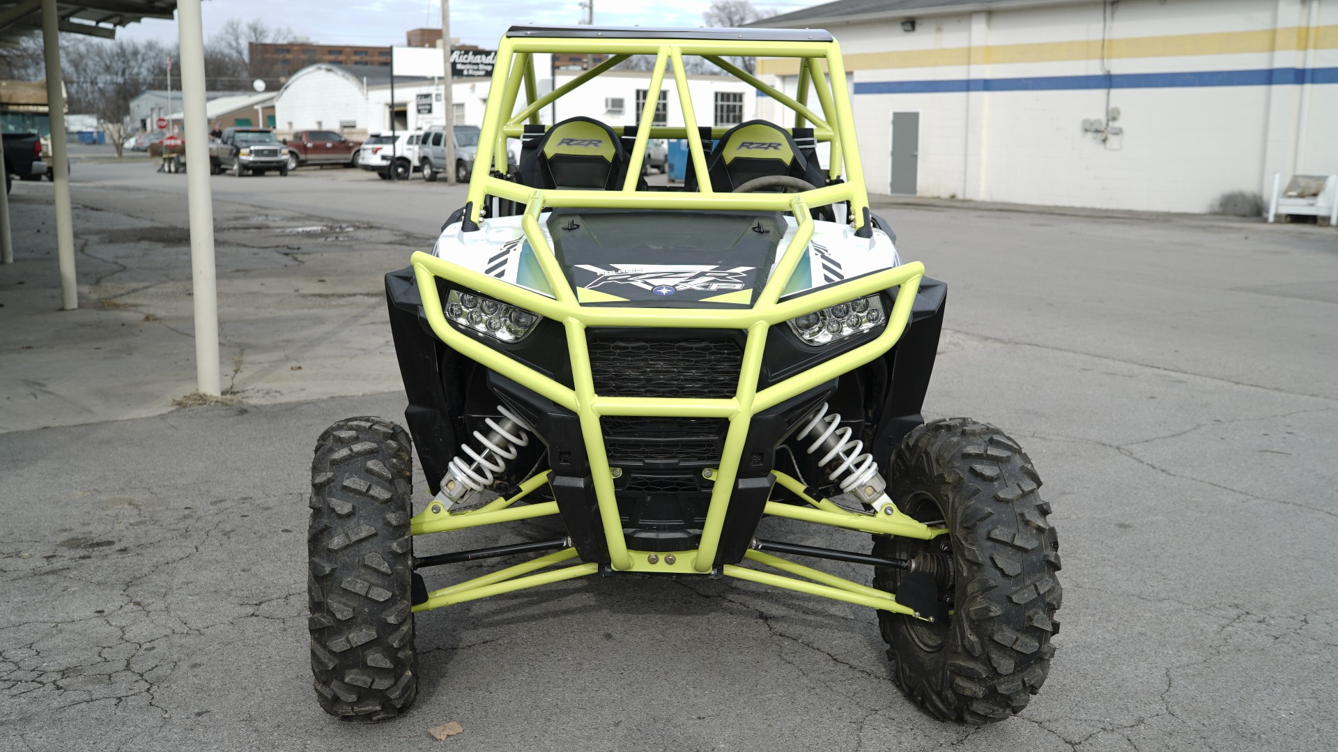 Polaris RZR 1000 with Yellow Roll Cage Front Bumper Image 1