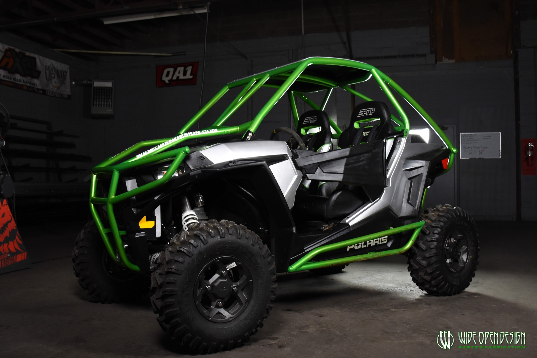Jason's 1000s RZR with Wide Open Design Rolled Roof Cage, Front Bumper with Tie In, and Rocker Guards 1