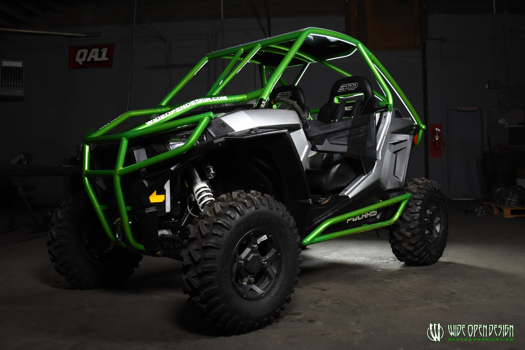 Jason's 1000s RZR with Wide Open Design Rolled Roof Cage, Front Bumper with Tie In, and Rocker Guards 2