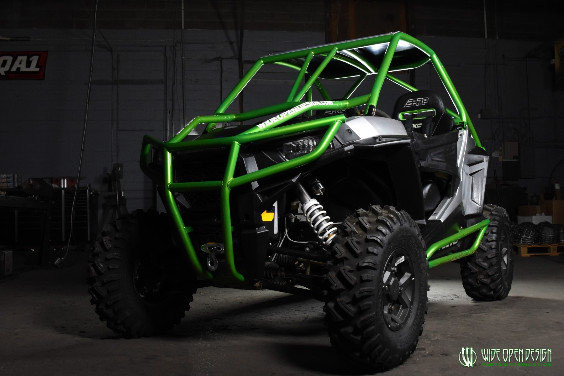 Jason's 1000s RZR with Wide Open Design Rolled Roof Cage, Front Bumper with Tie In, and Rocker Guards 3