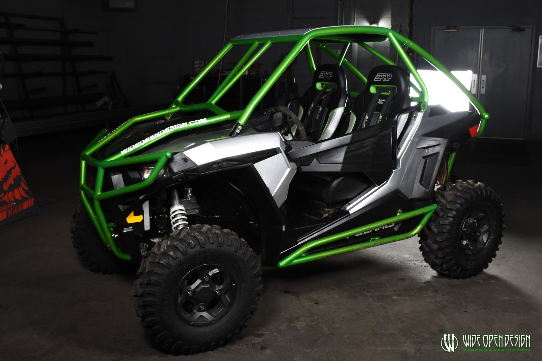 Jason's 1000s RZR with Wide Open Design Rolled Roof Cage, Front Bumper with Tie In, and Rocker Guards 4