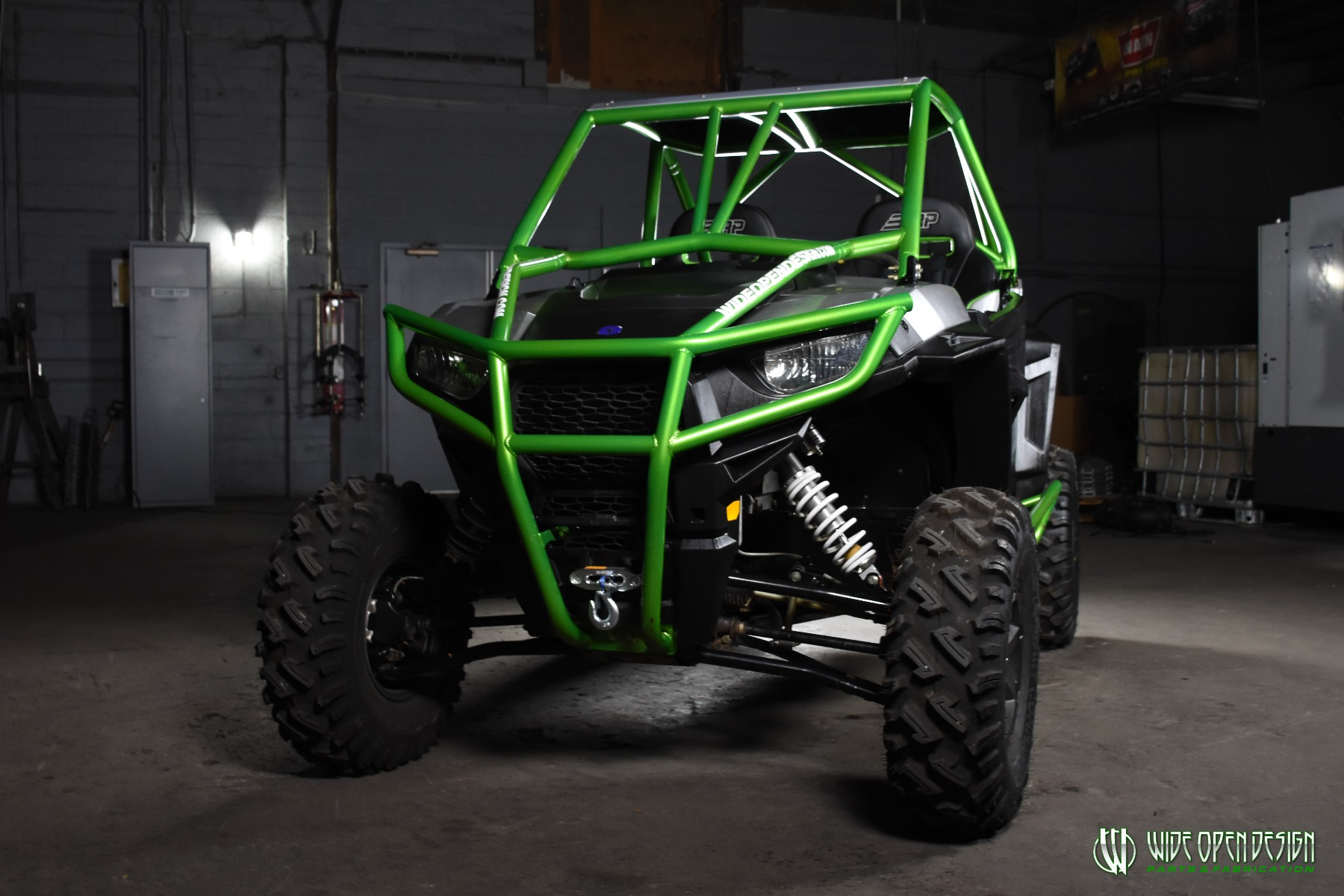 Jason's 1000s RZR with Wide Open Design Rolled Roof Cage, Front Bumper with Tie In, and Rocker Guards 5