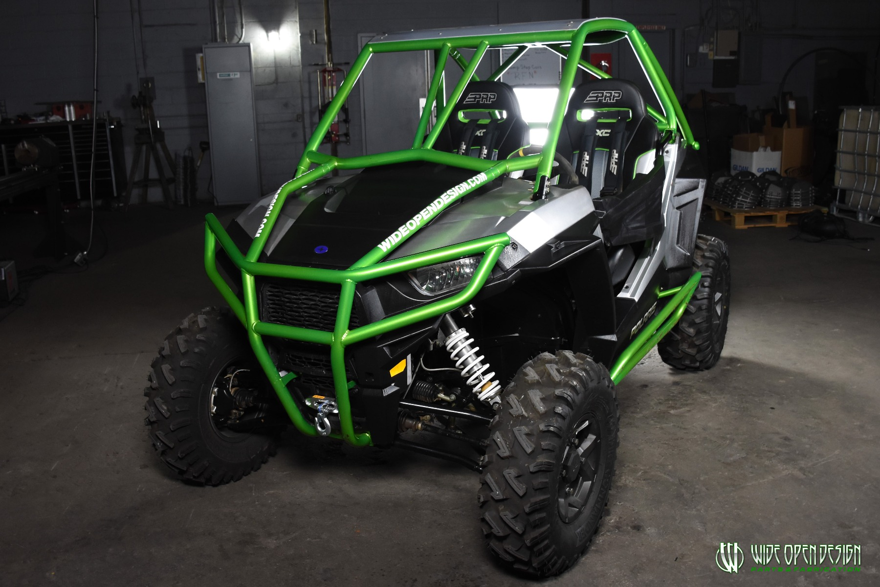 Jason's 1000s RZR with Wide Open Design Rolled Roof Cage, Front Bumper with Tie In, and Rocker Guards 6