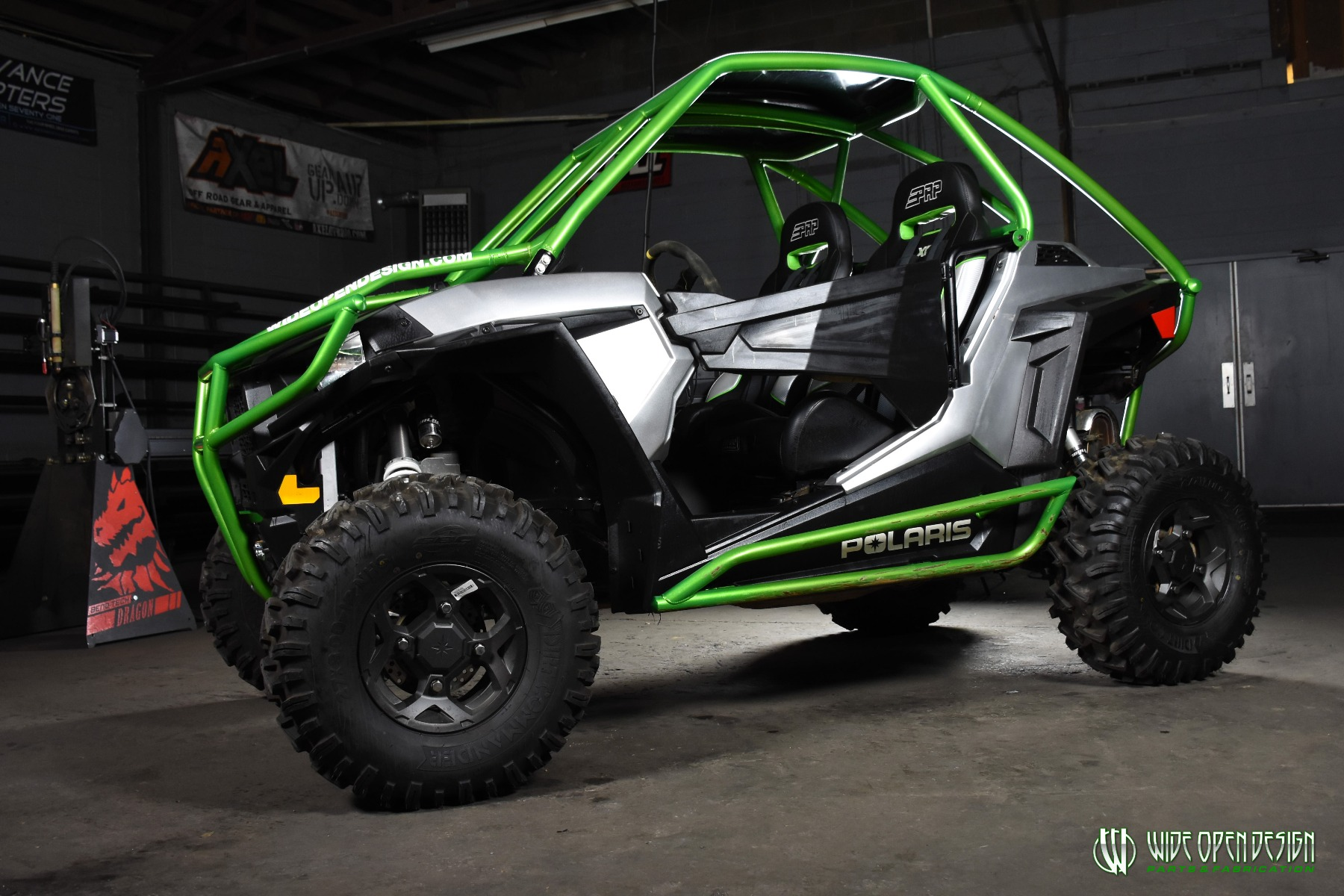 Jason's 1000s RZR with Wide Open Design Rolled Roof Cage, Front Bumper with Tie In, and Rocker Guards 7
