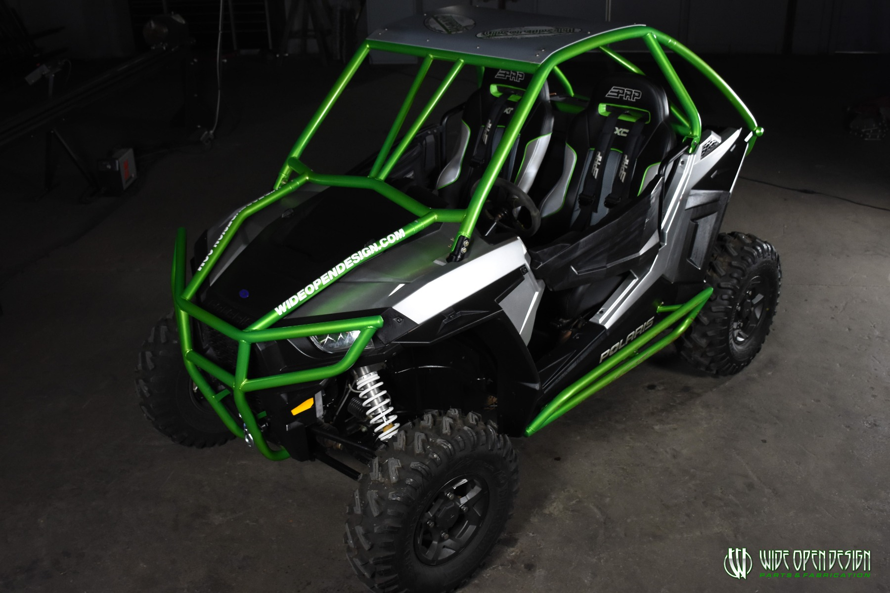 Jason's 1000s RZR with Wide Open Design Rolled Roof Cage, Front Bumper with Tie In, and Rocker Guards 8