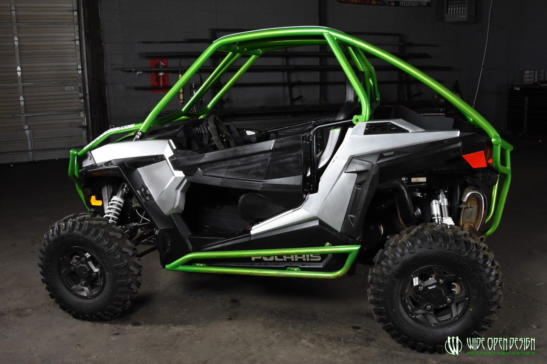 Jason's 1000s RZR with Wide Open Design Rolled Roof Cage, Front Bumper with Tie In, and Rocker Guards 18