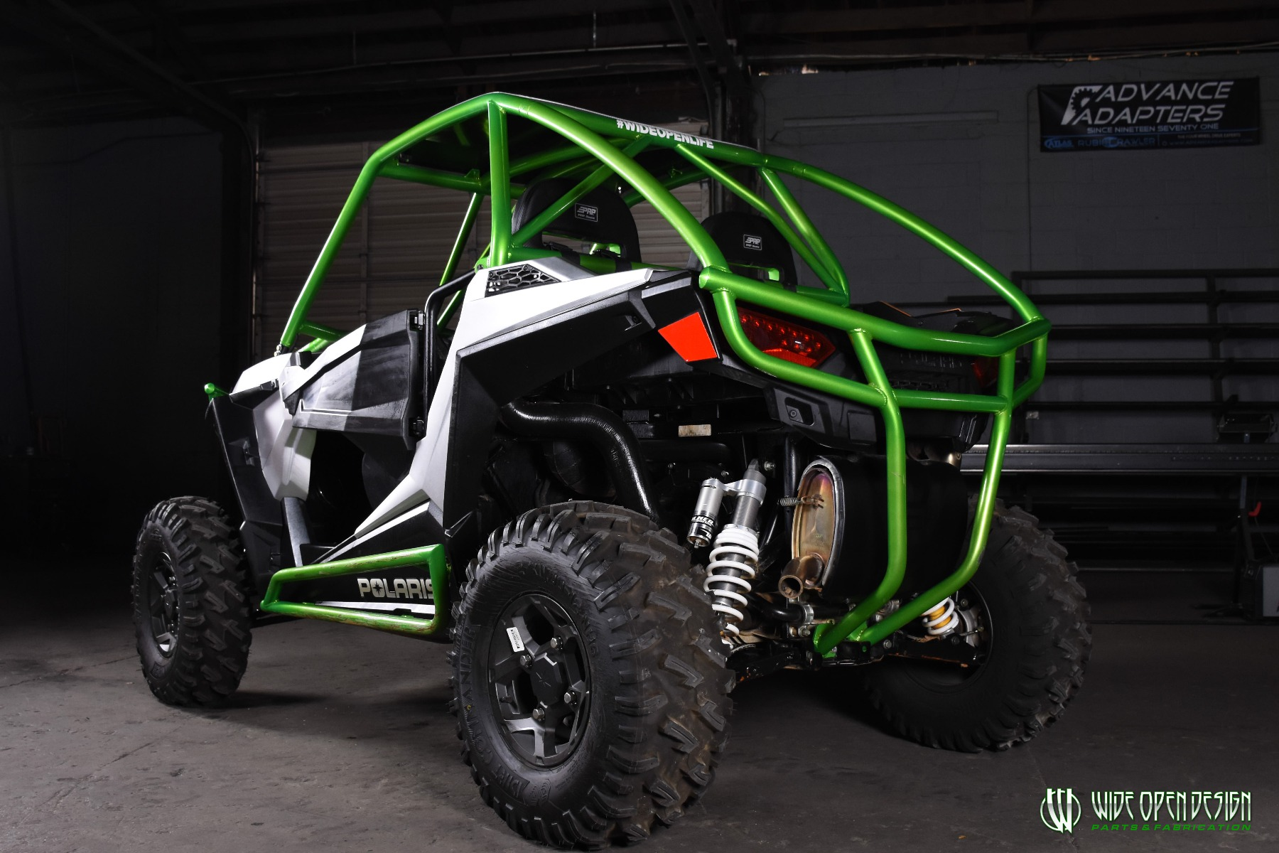 Jason's 1000s RZR with Wide Open Design Rolled Roof Cage, Front Bumper with Tie In, and Rocker Guards 24
