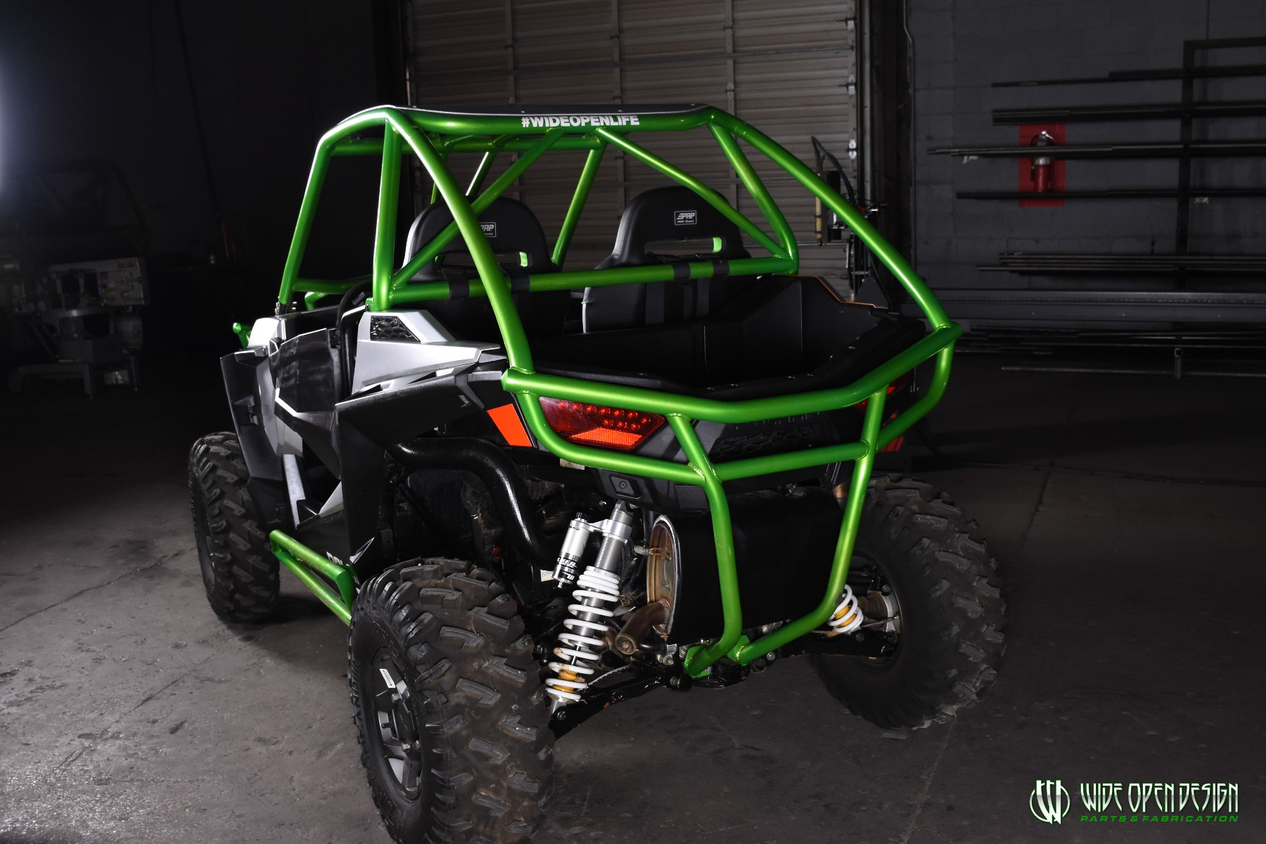 Jason's 1000s RZR with Wide Open Design Rolled Roof Cage, Front Bumper with Tie In, and Rocker Guards 25