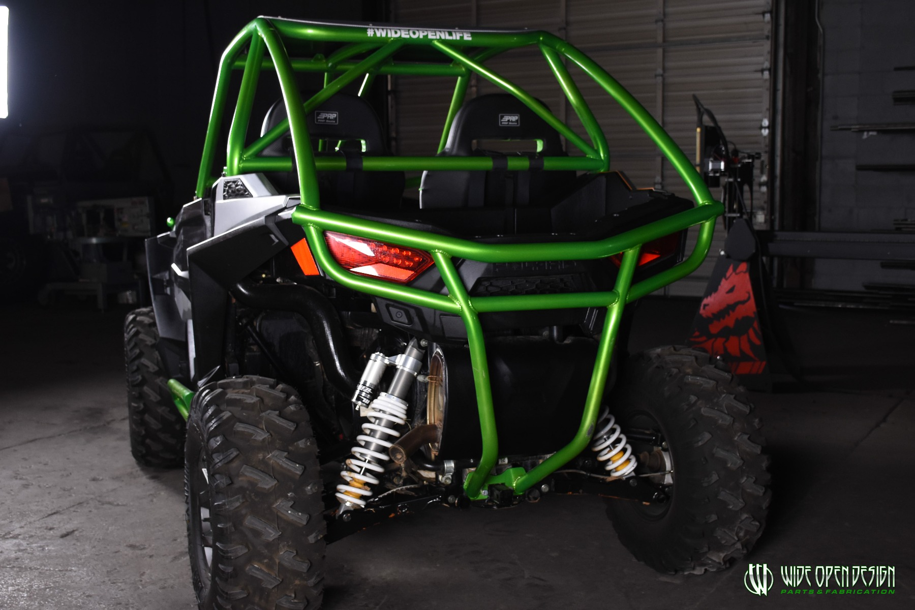 Jason's 1000s RZR with Wide Open Design Rolled Roof Cage, Front Bumper with Tie In, and Rocker Guards 26