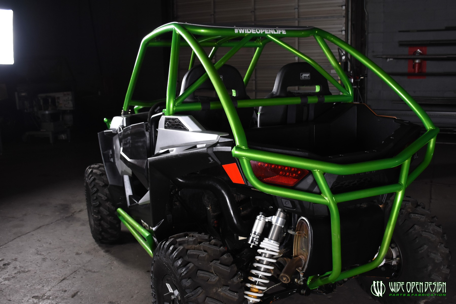 Jason's 1000s RZR with Wide Open Design Rolled Roof Cage, Front Bumper with Tie In, and Rocker Guards 27
