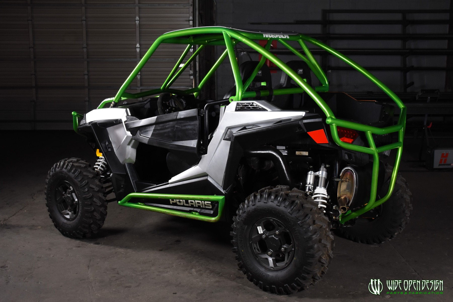 Jason's 1000s RZR with Wide Open Design Rolled Roof Cage, Front Bumper with Tie In, and Rocker Guards 28