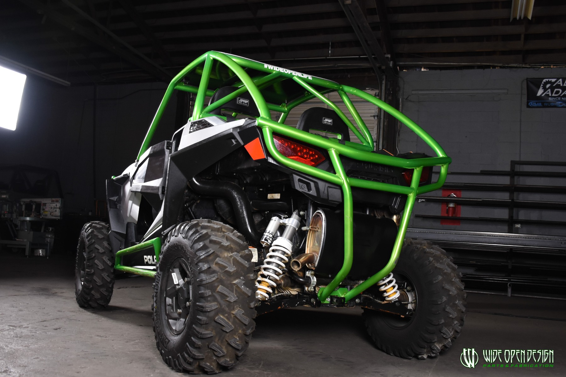 Jason's 1000s RZR with Wide Open Design Rolled Roof Cage, Front Bumper with Tie In, and Rocker Guards 29