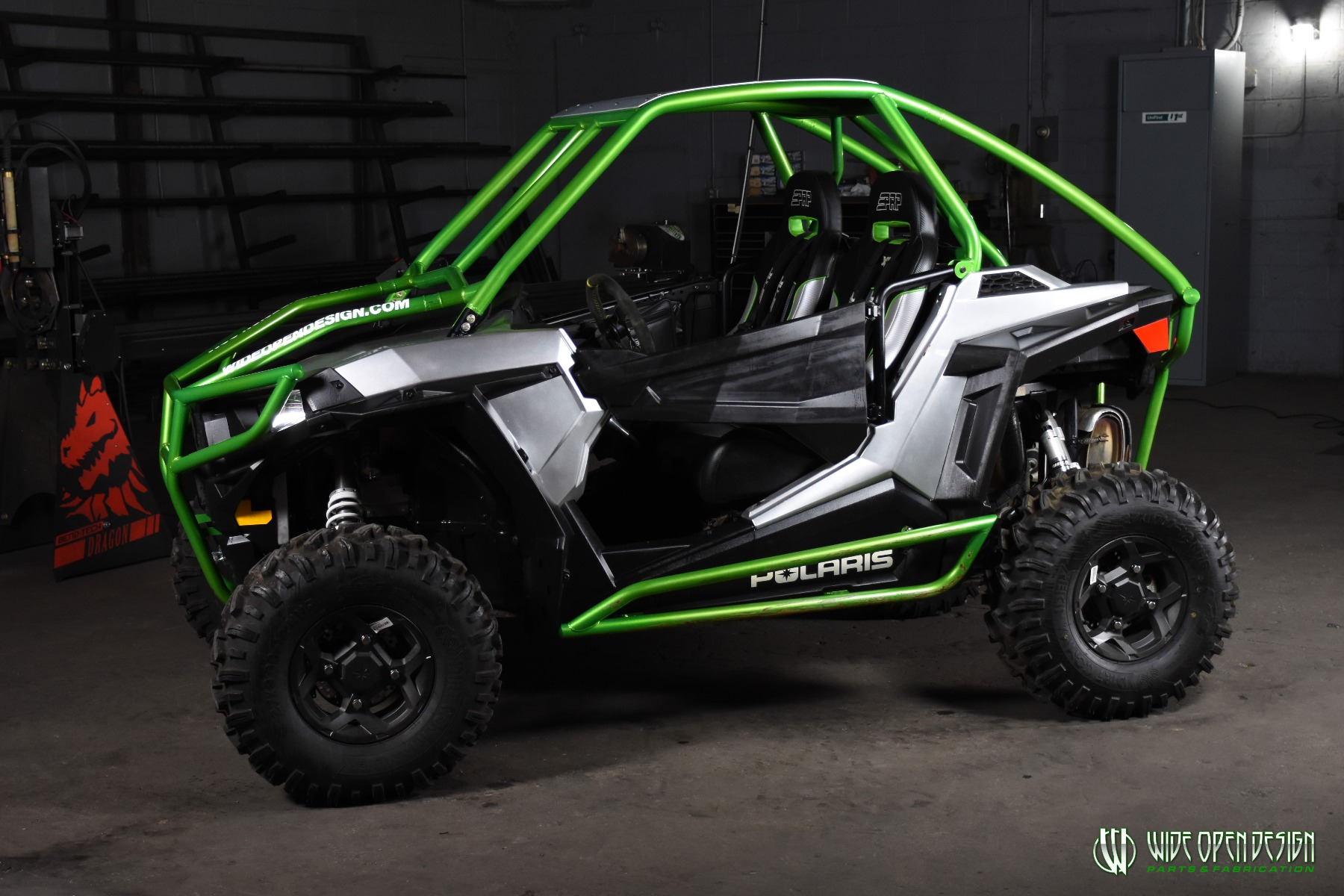 Jason's 1000s RZR with Wide Open Design Rolled Roof Cage, Front Bumper with Tie In, and Rocker Guards 19
