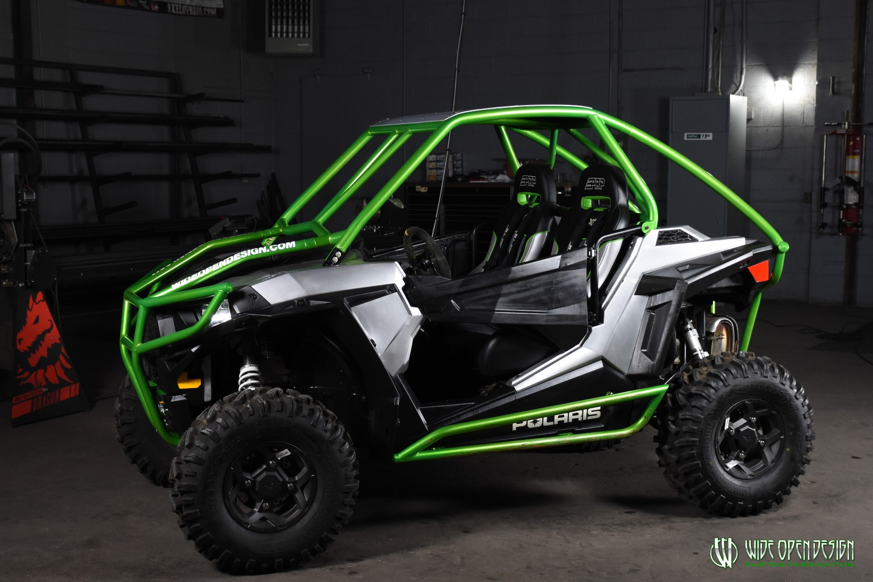 Jason's 1000s RZR with Wide Open Design Rolled Roof Cage, Front Bumper with Tie In, and Rocker Guards 20