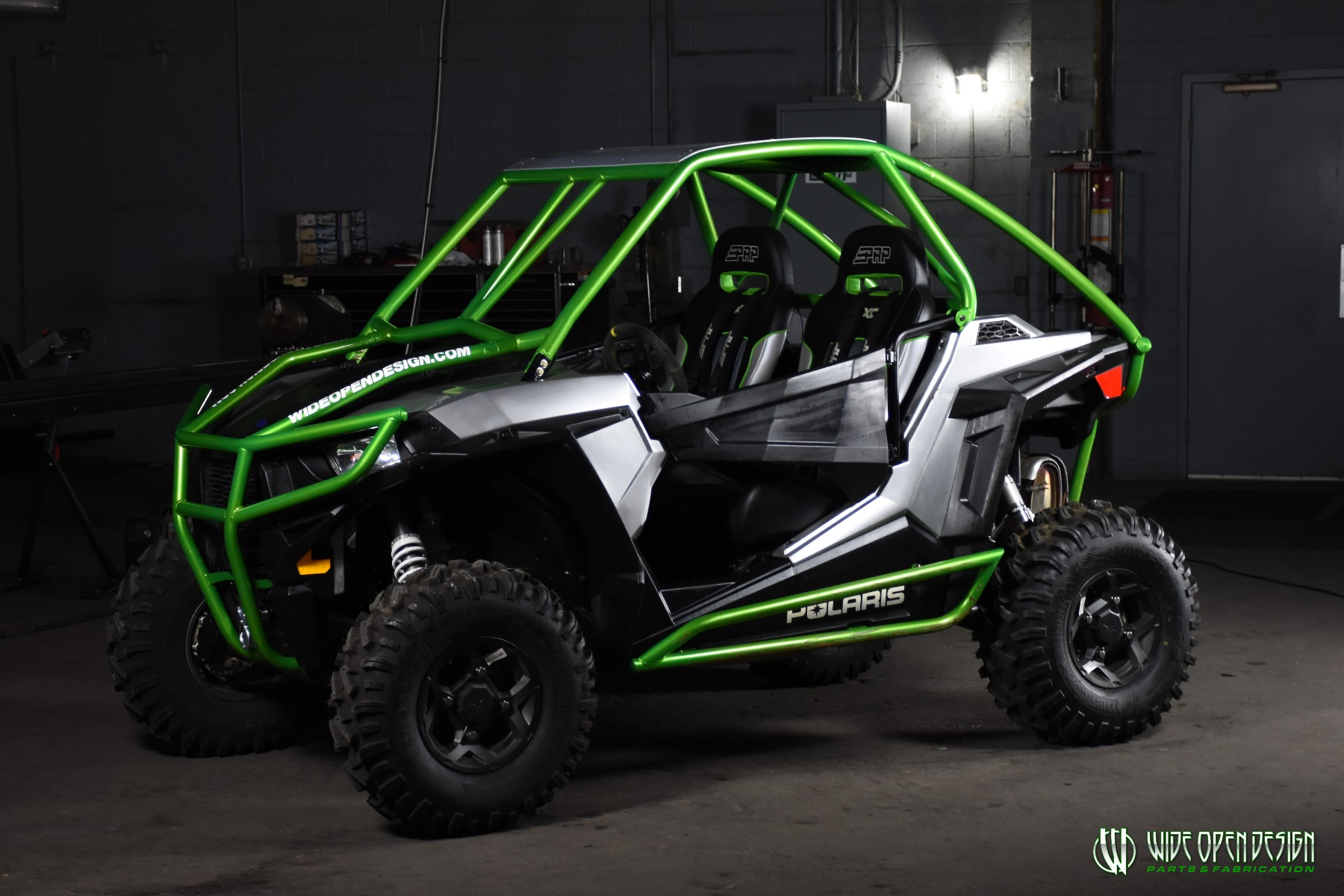 Jason's 1000s RZR with Wide Open Design Rolled Roof Cage, Front Bumper with Tie In, and Rocker Guards 10