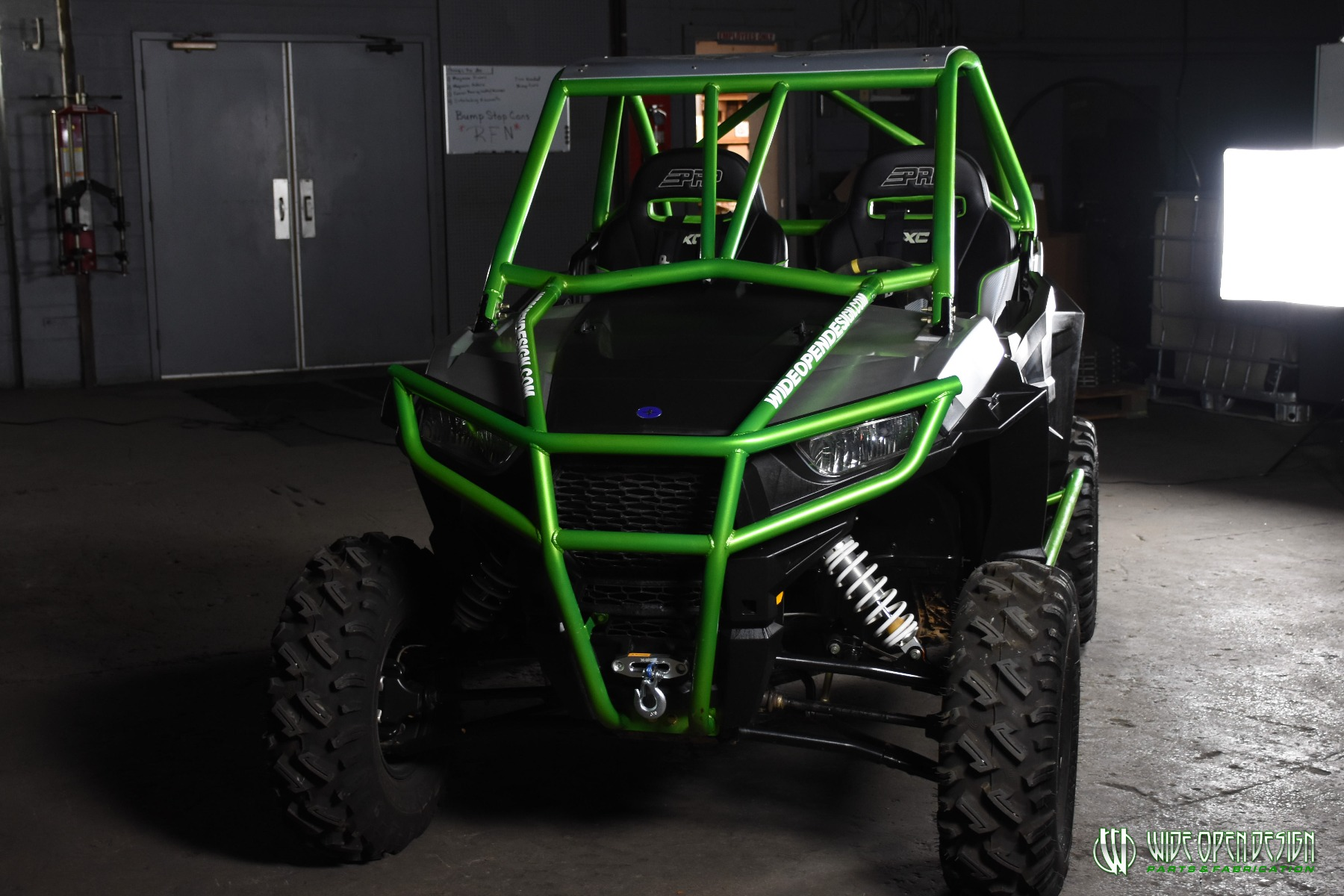 Jason's 1000s RZR with Wide Open Design Rolled Roof Cage, Front Bumper with Tie In, and Rocker Guards 12