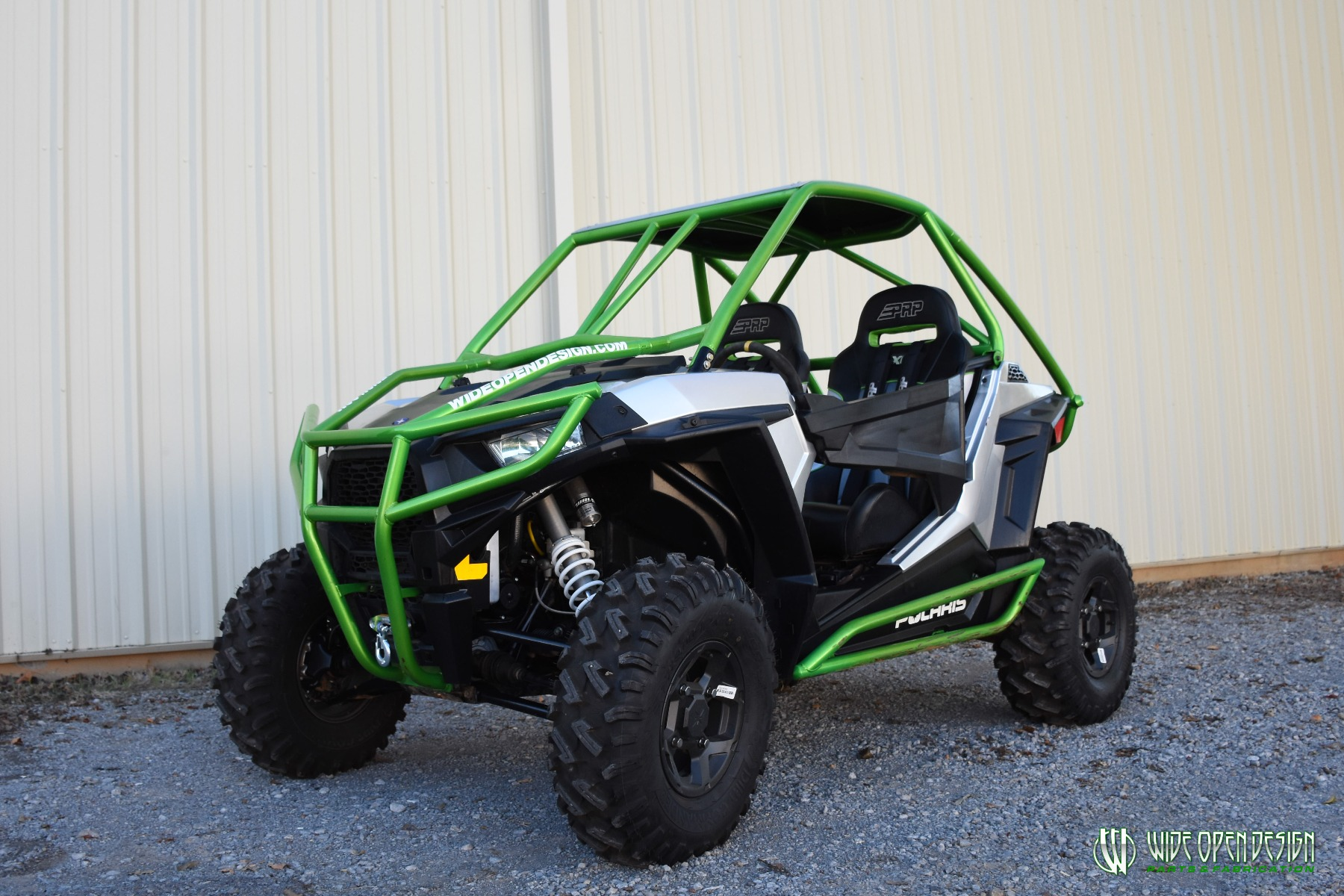 Jason's 1000s RZR with Wide Open Design Rolled Roof Cage, Front Bumper with Tie In, and Rocker Guards 13