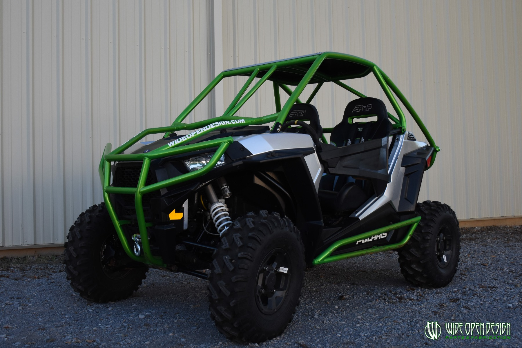 Jason's 1000s RZR with Wide Open Design Rolled Roof Cage, Front Bumper with Tie In, and Rocker Guards 14