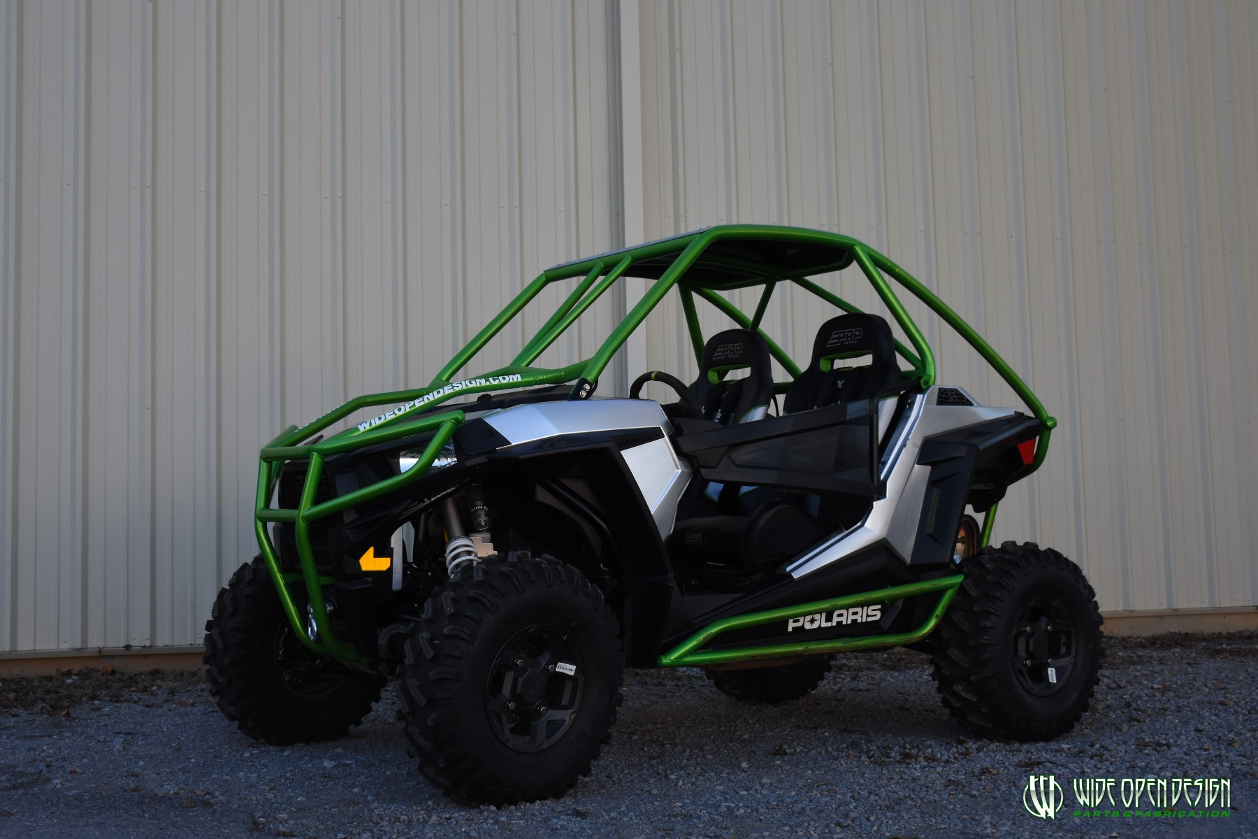 Jason's 1000s RZR with Wide Open Design Rolled Roof Cage, Front Bumper with Tie In, and Rocker Guards 15
