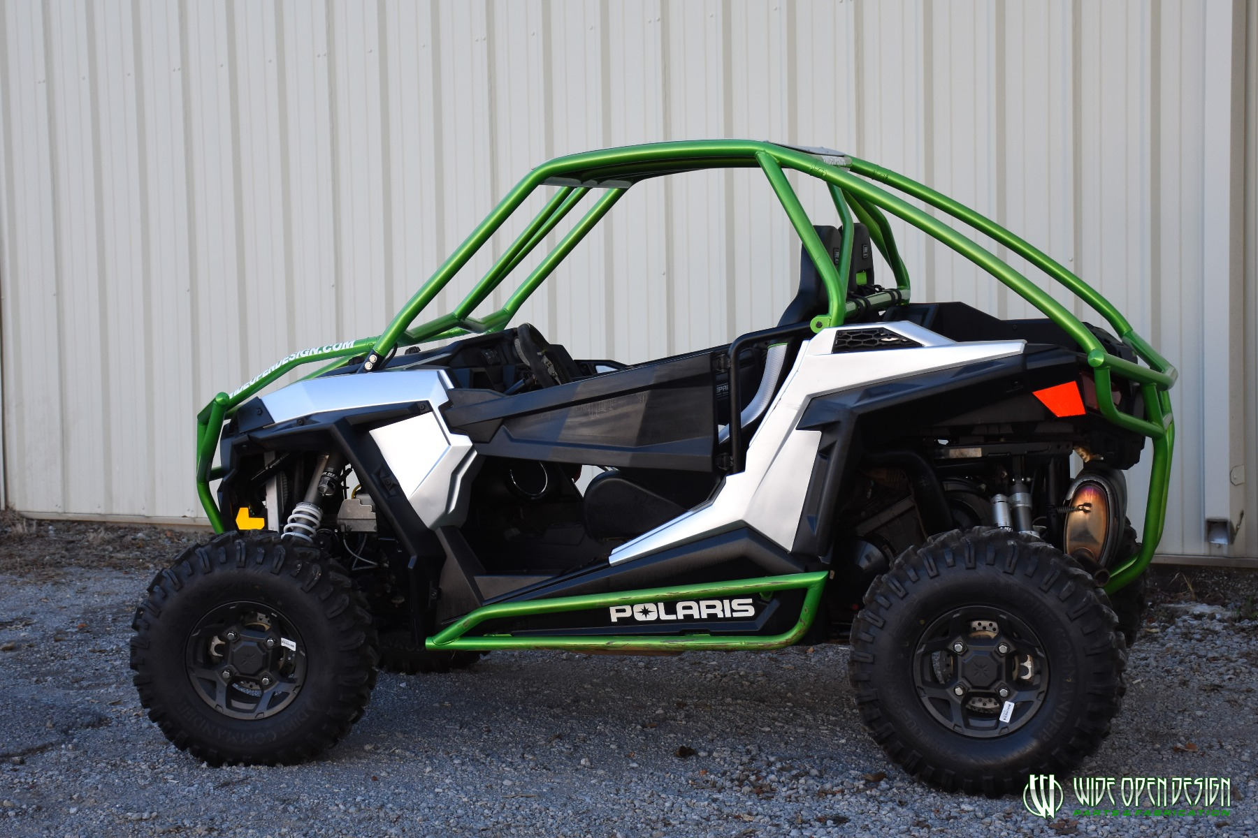 Jason's 1000s RZR with Wide Open Design Rolled Roof Cage, Front Bumper with Tie In, and Rocker Guards 21