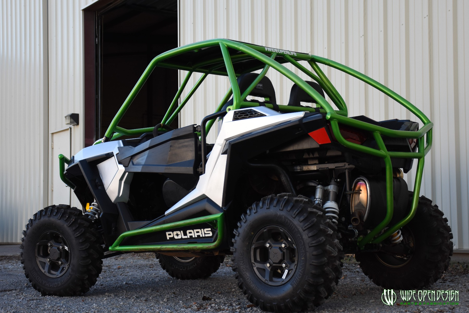 Jason's 1000s RZR with Wide Open Design Rolled Roof Cage, Front Bumper with Tie In, and Rocker Guards 22