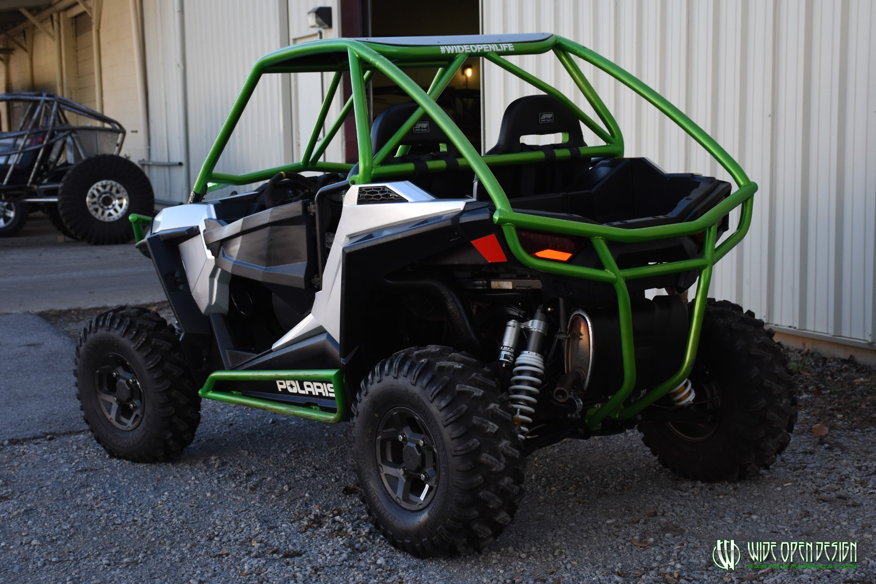 Jason's 1000s RZR with Wide Open Design Rolled Roof Cage, Front Bumper with Tie In, and Rocker Guards 30