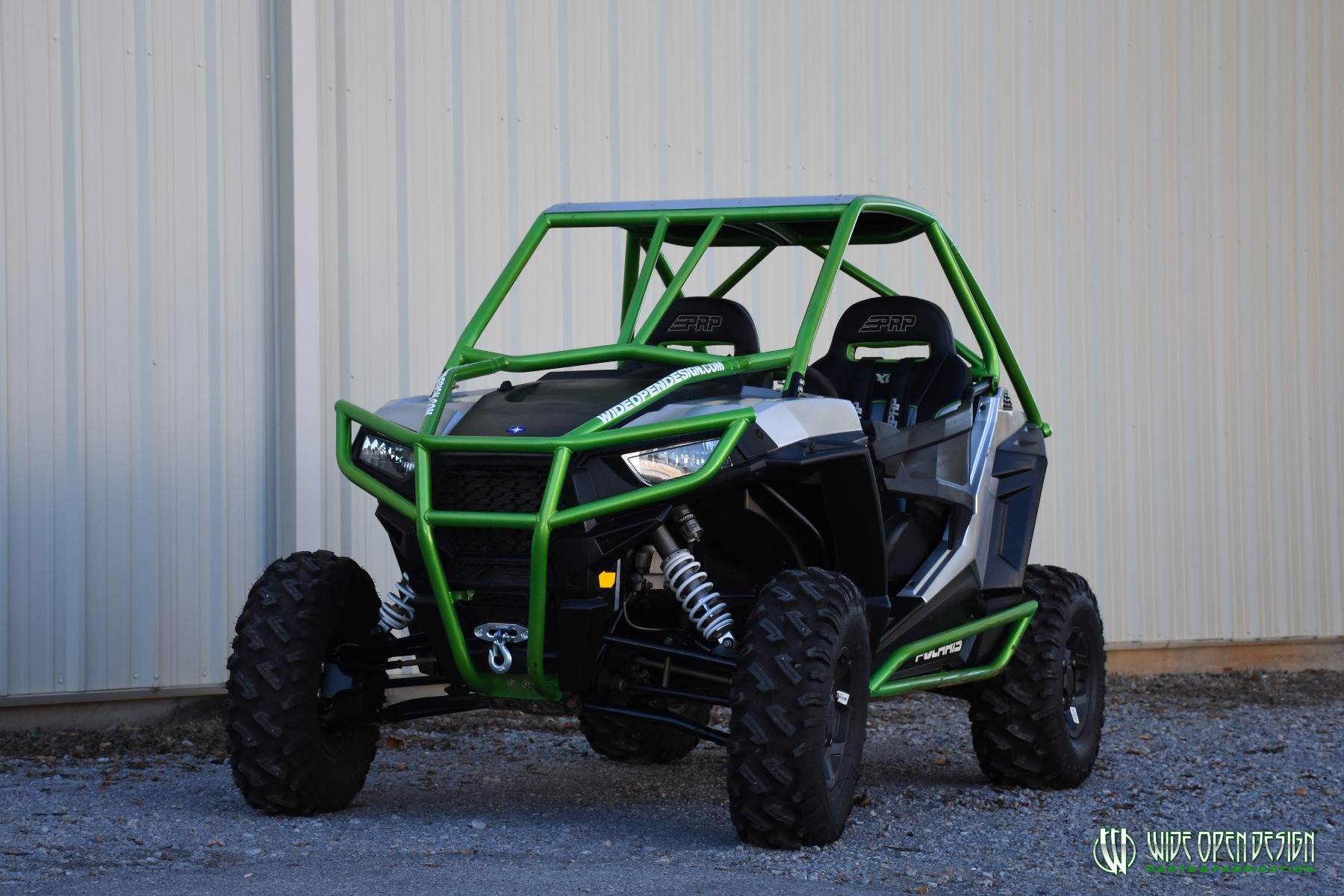 Jason's 1000s RZR with Wide Open Design Rolled Roof Cage, Front Bumper with Tie In, and Rocker Guards 16