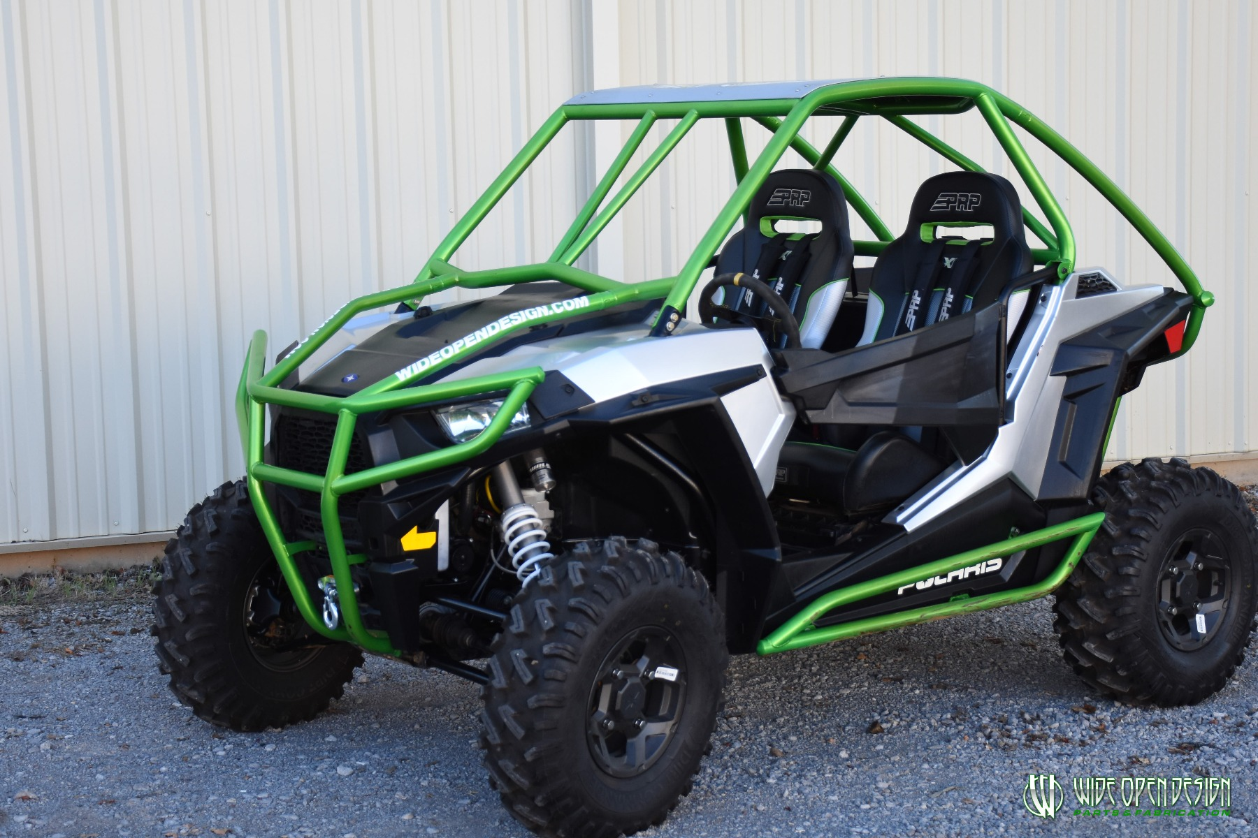 Jason's 1000s RZR with Wide Open Design Rolled Roof Cage, Front Bumper with Tie In, and Rocker Guards 17