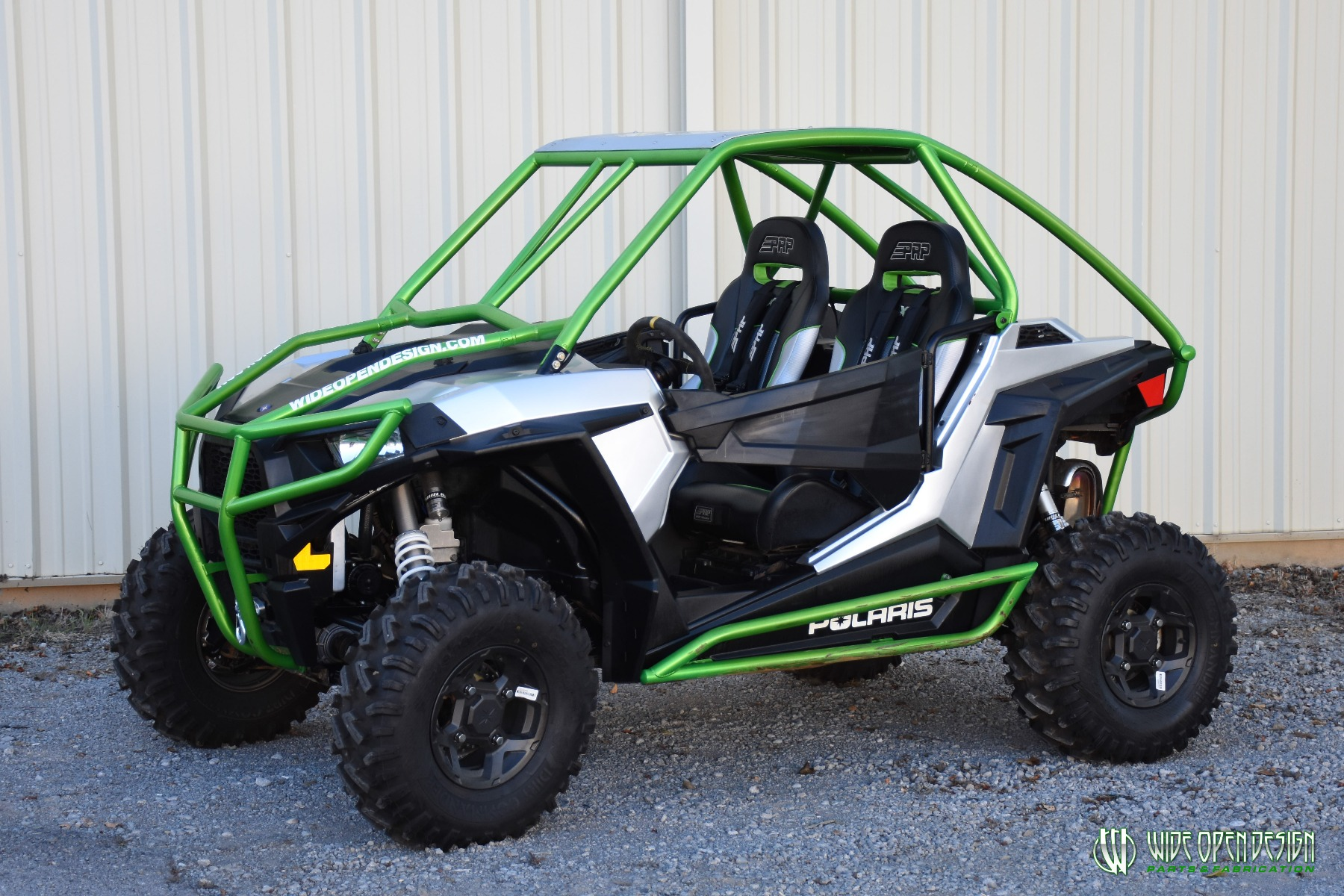 Jason's 1000s RZR with Wide Open Design Rolled Roof Cage, Front Bumper with Tie In, and Rocker Guards 23