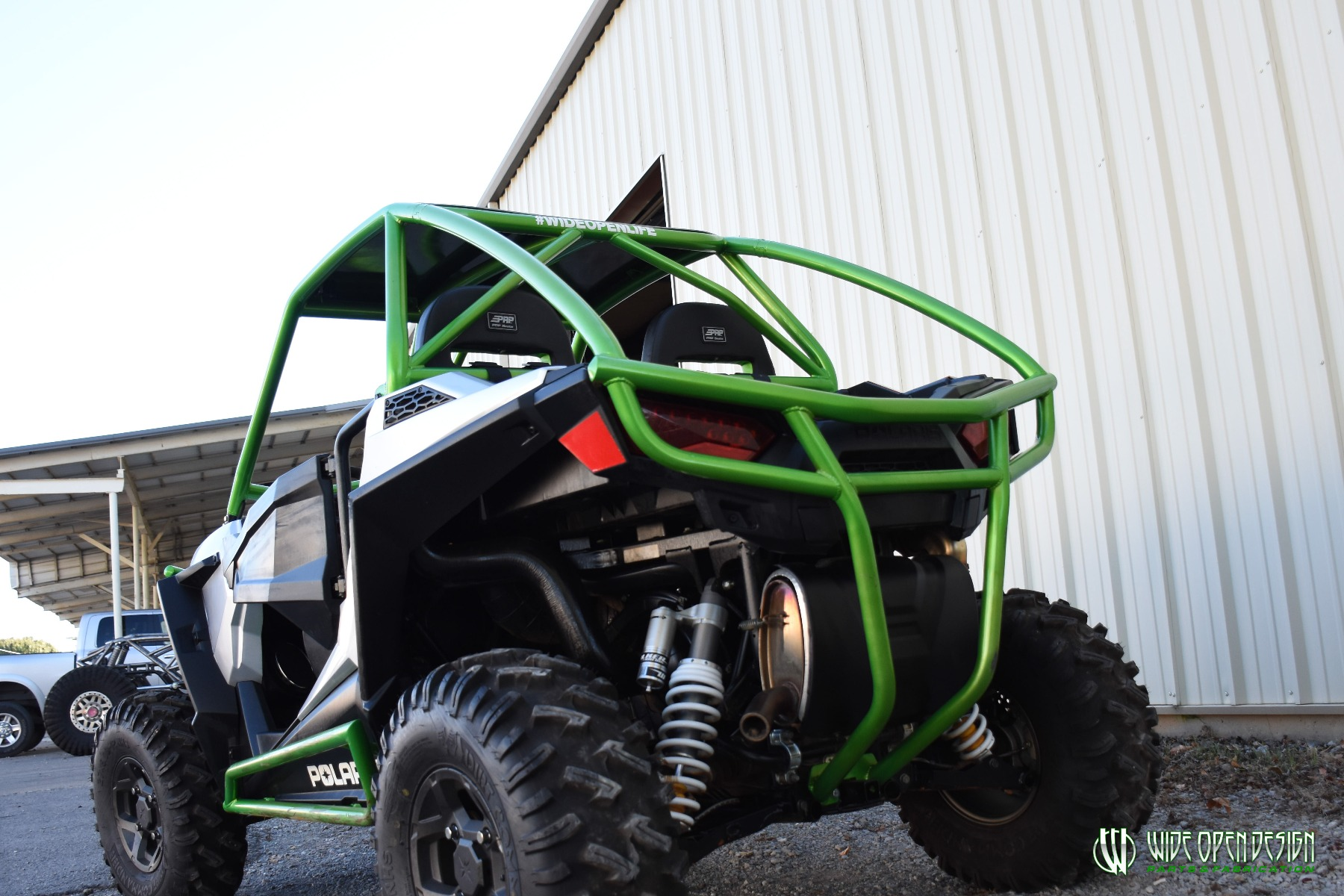 Jason's 1000s RZR with Wide Open Design Rolled Roof Cage, Front Bumper with Tie In, and Rocker Guards 31