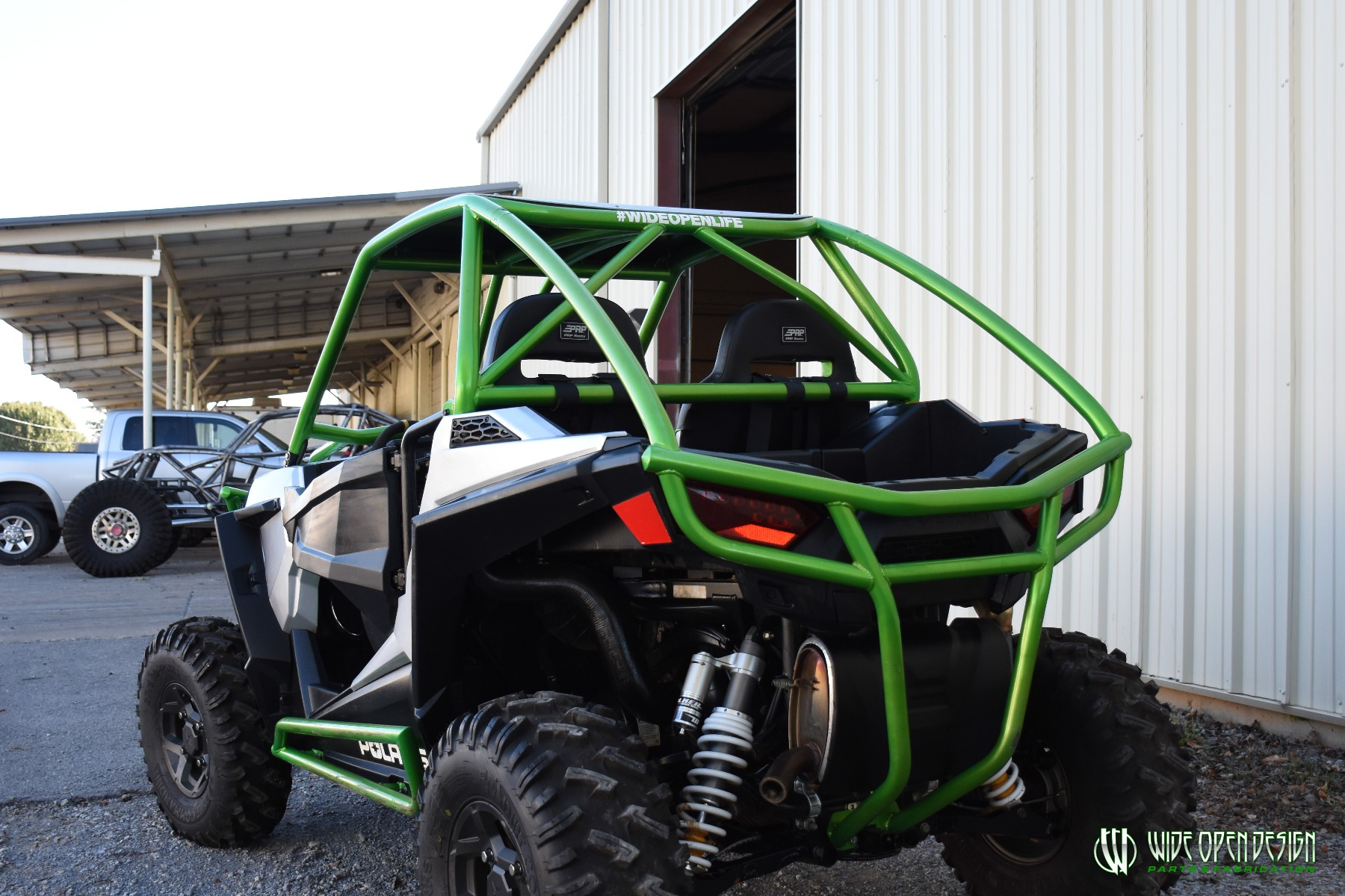 Jason's 1000s RZR with Wide Open Design Rolled Roof Cage, Front Bumper with Tie In, and Rocker Guards 32