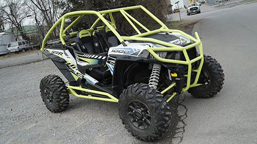 Polaris RZR 1000 with Yellow Rolled Roof Cage